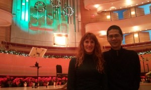 Jeri and Tim with the Organ Drenched in Christmas Lights. Click photo for full size.