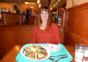 Jeri at Dharma's with Szechuan Tofu and Vegan Lemon Raspberry Cheesecake. Click photo to view full size.
