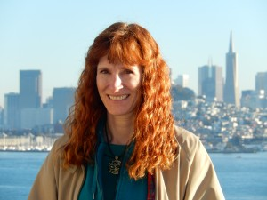Jeri on Alcatraz Island with San Francisco behind her. Click photo to view full size.