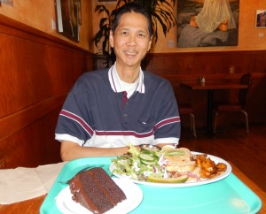 Tim at Dharma's with Tempeh Rueben and Vegan Chocolate Cake. Click photo to view full size.