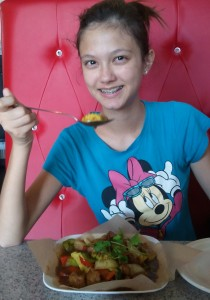 Lizzie having vegan Lemon Grass Chicken. Click photo for full size.